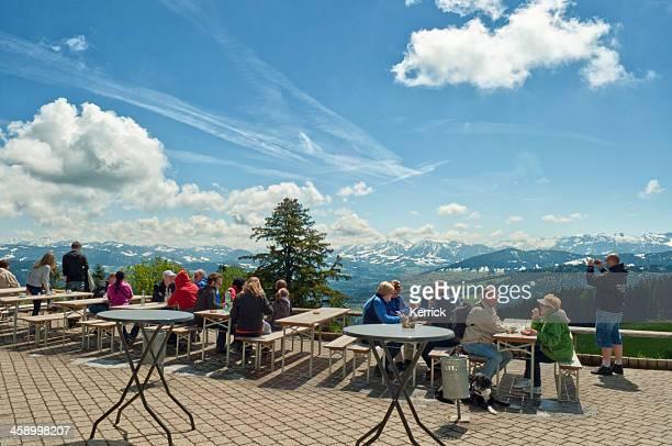 hiking people resting at pfander with view to bregenzerwald - bregenz stockfoto's en -beelden