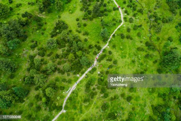 hiking road in a mountain aerial,shoot by a drone - team photo ストックフォトと画像