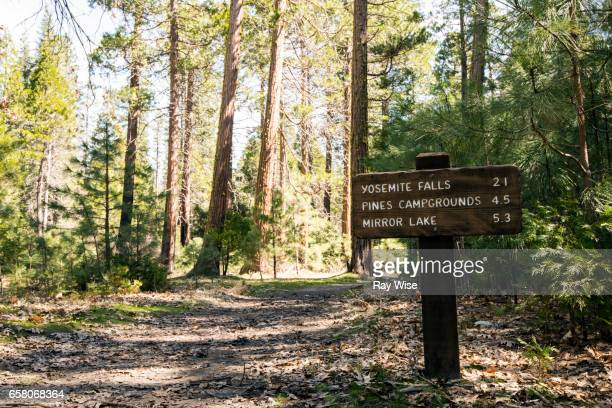 hiking sign in yosemite national park - track imprint stock photos and pictures