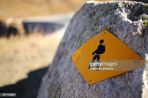 Hiking sign on a rock