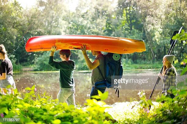 hiking teenagers at the lake