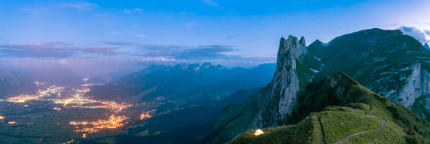 Hiking tent with St.Gallen on background at night, Switzerland