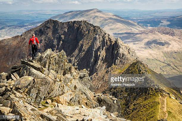 hiking the crib goch trail on mount snowdon - mount snowdon stock photos and pictures