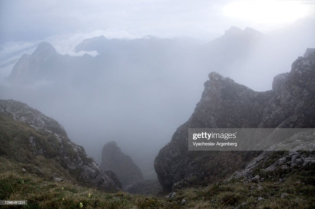 Hiking the slopes of Asbestnaya Mount in heavy fog and clouds, Adygea, Caucasus Mountains : Stock Photo