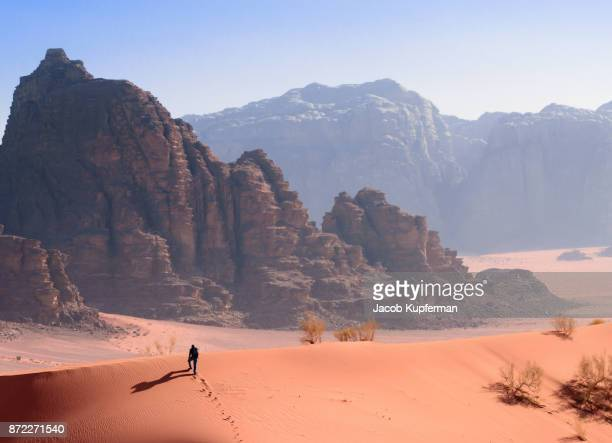 hiking through the desert in wadi rum - jordan middle east stock pictures, royalty-free photos & images