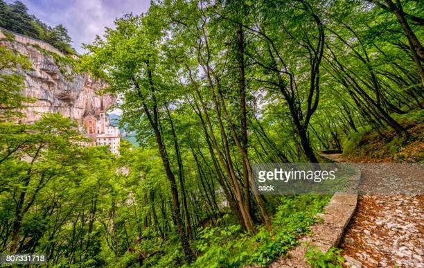 hiking through the forest of madonna della corona - corona stock pictures, royalty-free photos & images