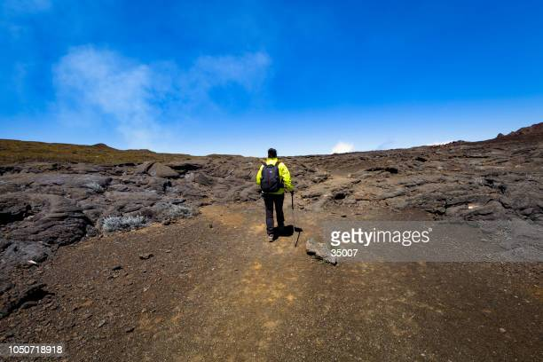 hiking through the lava fields of piton de la fournaise, reunion island - lava plain stock pictures, royalty-free photos & images