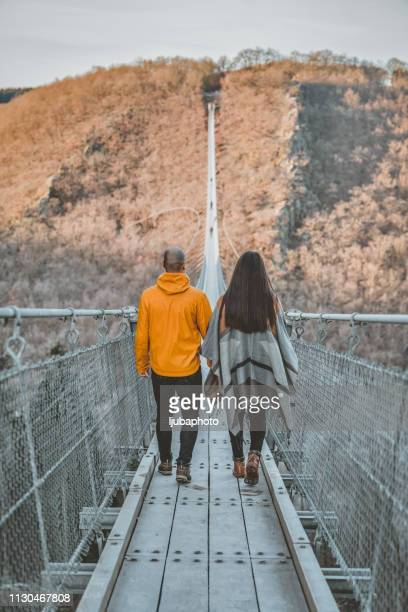 hiking to greater destinations - heterosexual couple stock pictures, royalty-free photos & images