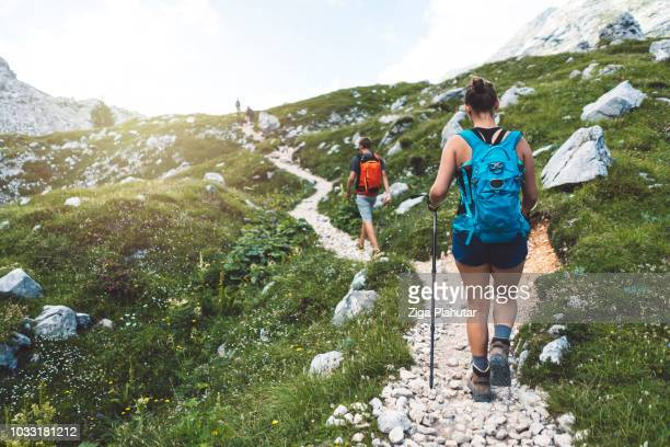 hiking together - slovenia stock pictures, royalty-free photos & images