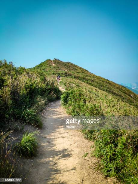 hiking trails at the dargon's back, shek o, hong kong - vsojoy stock pictures, royalty-free photos & images