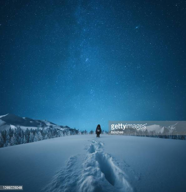 hiking under the starry sky - winter sky stock pictures, royalty-free photos & images