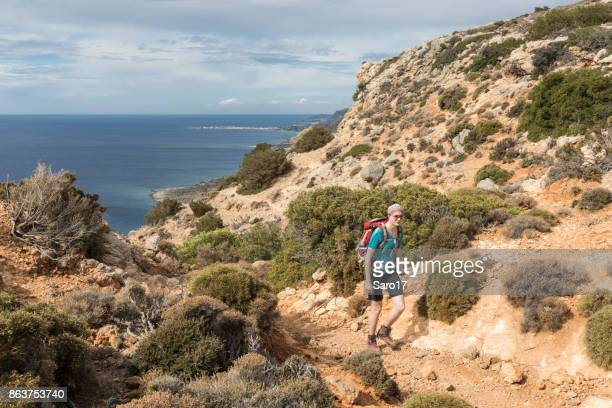 hiking uphill at southwestern coastline of crete. - tinted sunglasses stock pictures, royalty-free photos & images