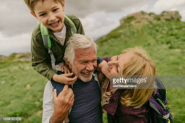 hiking with my grandparents - grandson stock pictures, royalty-free photos & images