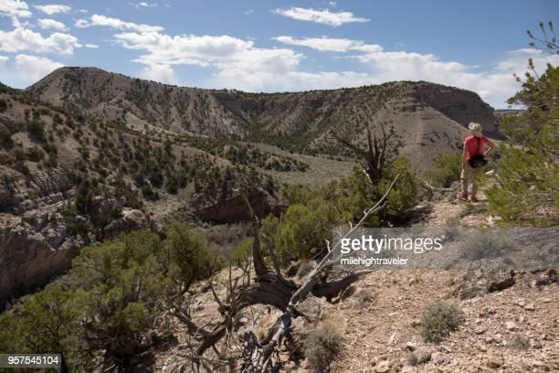 Hiking woman explores Vermillion Canyon Colorado Browns Park State Wildlife Area