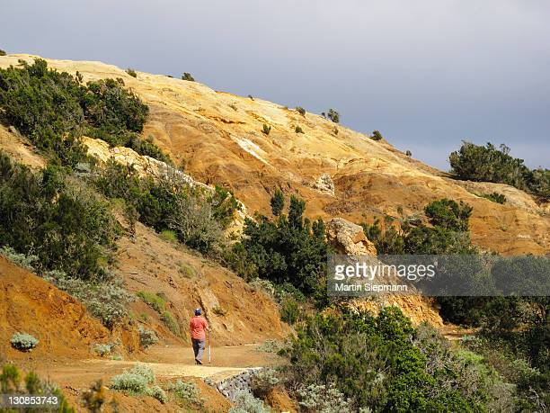 Hiking woman in eroded landscape, Cumbre de Chijeré in Vallehermoso, La Gomera, Canary Islands, Spain, Europe