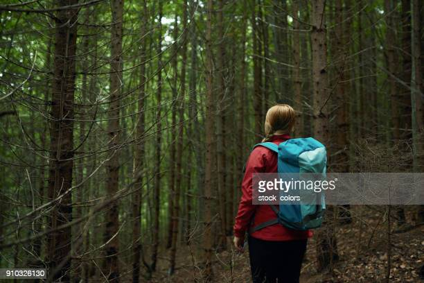hiking woman in the forest
