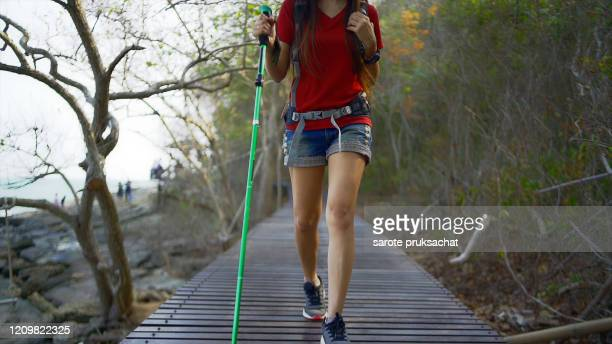 hiking woman with  on the trail holiday, wild adventure. background for travel concept . - teenage girls feet stock-fotos und bilder