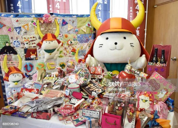 Hikonyan the city mascot of Hikone in Shiga Prefecture western Japan poses with hundreds of chocolates it received for Valentine's Day at the city...