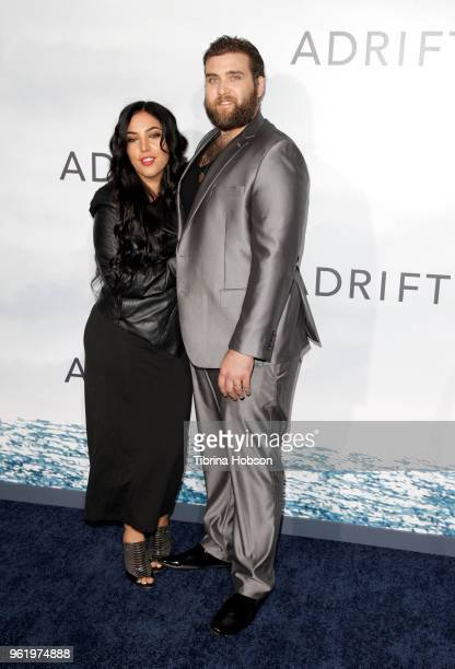 Hila Aronian and Weston Cage attend the premiere of 'Adrift' at Regal LA Live Stadium 14 on May 23 2018 in Los Angeles California