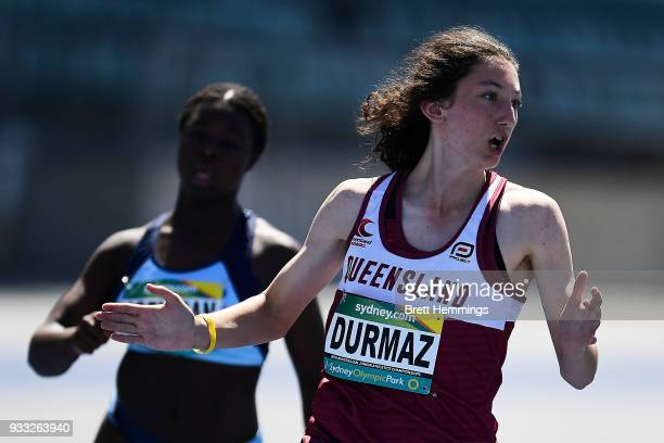 Hilal Durmaz of Queensland wins her Womens 100m Under 15 final during day five of the Australian Junior Athletics Championships at Sydney Olympic...