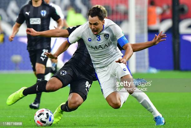 Hilal's defender Carlos Eduardo is tackled by Monterrey's midfielder William Mejia during the 2019 FIFA Club World Cup 3rd place playoff football...
