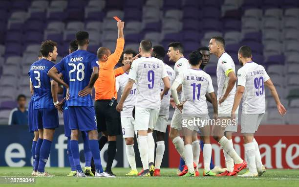 Hilal's defender Ismail Ahmed receives a red card during the AFC champions league Group C football match between UAE's AlAin and Saudi Arabia's Al...