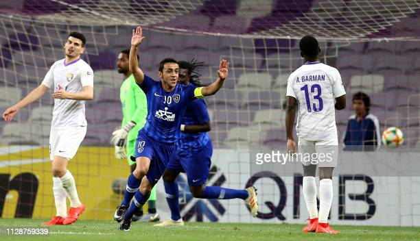 Hilal's midfielder Mohammad AlShalhoub celebrates after scoring during the AFC champions league Group C football match between UAE's AlAin and Saudi...