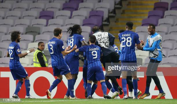 Hilal's players celebrate their goal during the AFC champions league Group C football match between UAE's AlAin and Saudi Arabia's Al Hilal at the...