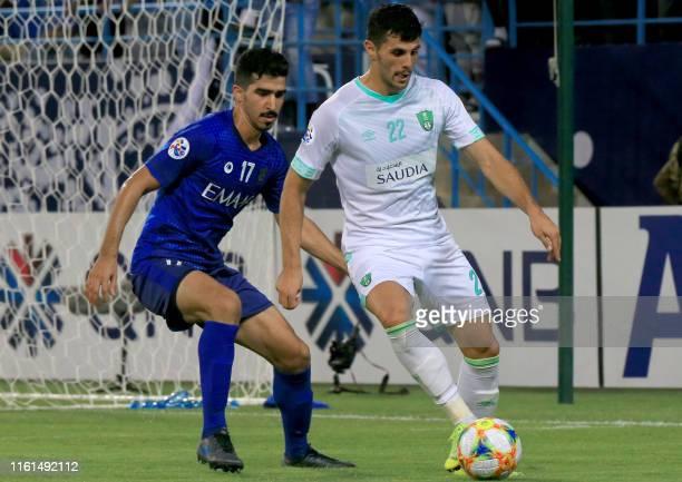 Hilal's Saudi defender Abdullah al-Hafith vies for the ball against Ahli Saudi's Serbian midfielder Danijel Aleksic during the AFC Champions League...