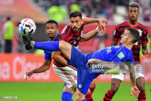 Hilal's Sebastian Giovinco controls the ball as he is marked by Flamengo's defender Pablo Marí during the 2019 FIFA Club World Cup semi-final...