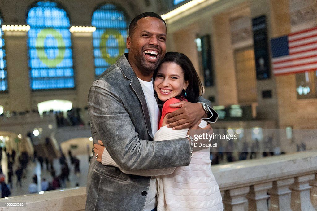 Hilaria Baldwin (R) and AJ Calloway visit 'Extra' at Michael Jordan's The Steak House N.Y.C. in Grand Central Terminal on March 7, 2013 in New York City.