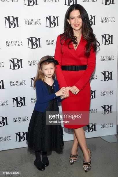 Hilaria Baldwin and Carmen Gabriela Baldwin attend the Badgley Mischka front row during New York Fashion Week: The Shows at Gallery I at Spring...