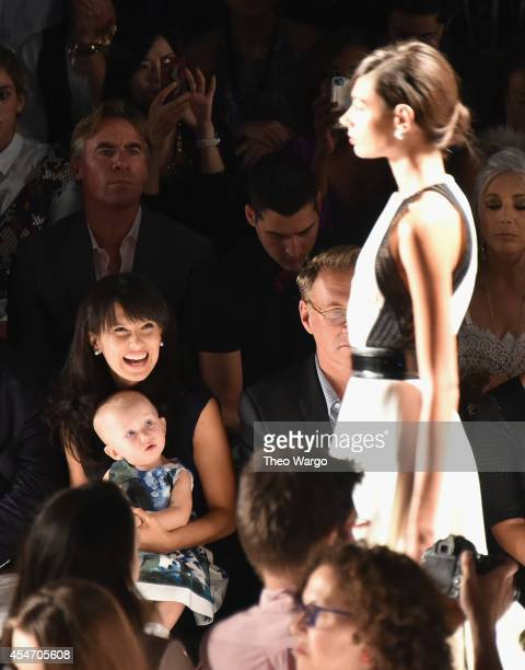 Hilaria Baldwin and daughter Carmen Baldwin attend Carmen Marc Valvo during Mercedes-Benz Fashion Week Spring 2015 at The Theatre at Lincoln Center...