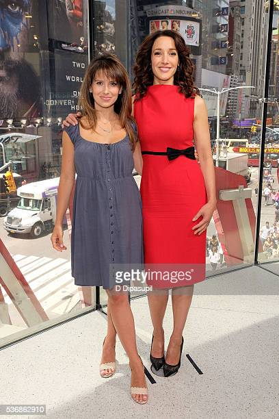 Hilaria Baldwin and Jennifer Beals pose on the set of 'Extra' at their New York studios at HM in Times Square on June 1 2016 in New York City