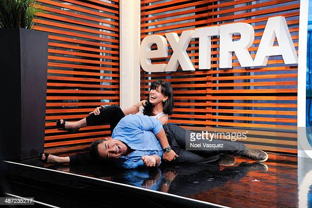 Hilaria Baldwin and Mario Lopez practice yoga at Extra at Universal Studios Hollywood on April 28 2014 in Universal City California