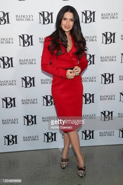 Hilaria Baldwin attends the Badgley Mischka front row during New York Fashion Week: The Shows at Gallery I at Spring Studios on February 08, 2020 in...