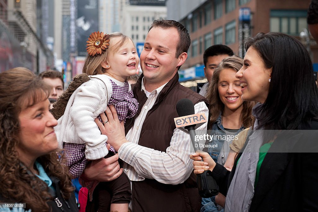 Hilaria Baldwin (R) interviews Josh Duggar and his daughter during their visit with 'Extra' in Times Square on March 11, 2013 in New York City.
