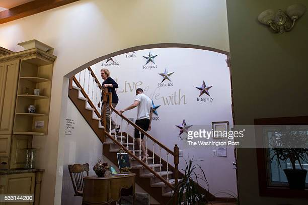 Hilarie Cash and Ryan Duncan walk up the stairs at reSTART a rehabilitation center for digital media addiction in Fall City Washington on May 13 2016...