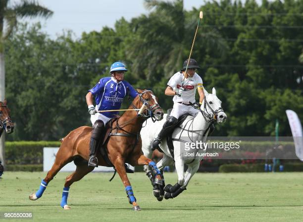 Hilario Ulloa of the Daily Racing Form rides up field against Bob Jornayvaz of Valiente during the Final match of the US Open Polo Championship on...