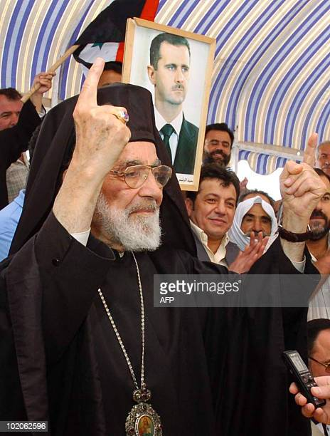 Hilarion Capucci the retired titular archbishop of Caesarea for the Melkite Greek Catholic Church acknowledges the upon his arrival at the...