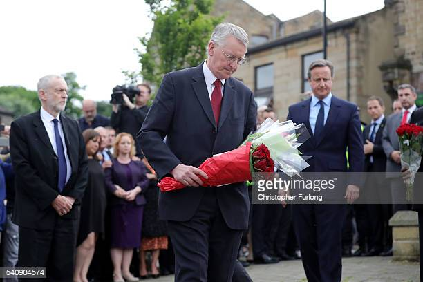 Hilary Benn MP for Leeds Central lays flowers near to the scene of the murder of Jo Cox Labour MP for Batley and Spen who was shot and stabbed...