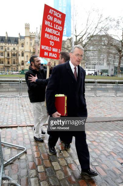 Hilary Benn the current Secretary of State for Environment Food and Rural Affairs is pursued by an antiwar protester as he arrives at the Queen...