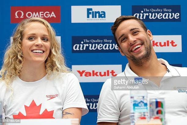 Hilary Caldwell of Canada and Chad le Clos of South Africa reacts on stage during the International Swim Stars Meet and Greet at Kallang Wave Mall...