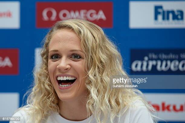 Hilary Caldwell of Canada reacts on stage during the International Swim Stars Meet and Greet at Kallang Wave Mall Atrium ahead of the FINA Swimming...