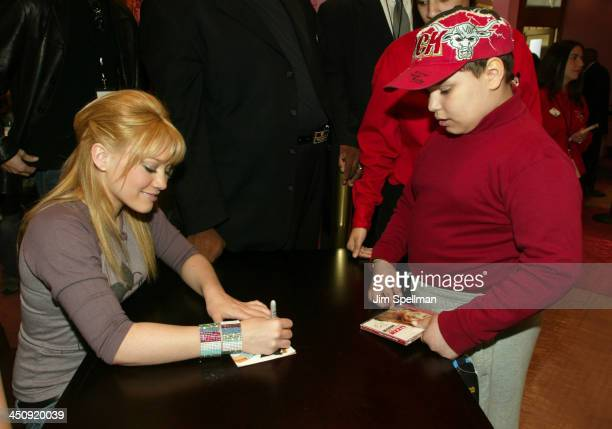 Hilary Duff and a young fan during Hilary Duff at the Disney Store at The Disney Store Fifth Avenue in New York City New York United States