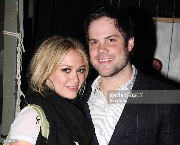 Hilary Duff and boyfriend Mike Comrie pose backstage at the hit play 'Reasons to be Pretty' on Broadway at The Lyceum Theater on May 16 2009 in New...