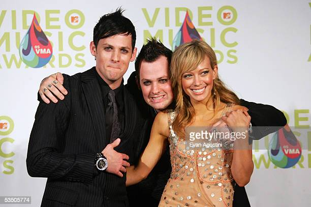 Hilary Duff and Joel Madden and Benji Madden of Good Charlotte pose in the press room during the 2005 MTV Video Music Awards at the American Airlines...