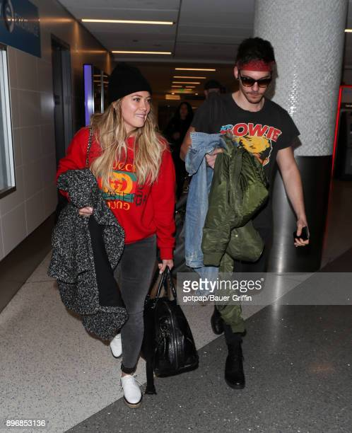 Hilary Duff and Matthew Koma are seen at LAX on December 21 2017 in Los Angeles California