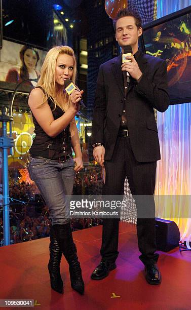 Hilary Duff and MTV VJ Damien Fahey during MTV's New Year's Eve 2004 Show at MTV Studios Times Square in New York City New York United States