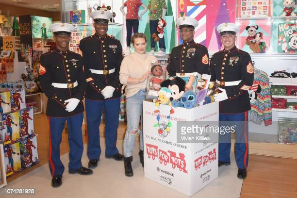 Hilary Duff with Toys for Tots marines kick off Disney store and shopDisneys Holiday campaign at Disney store on November 26 2018 in Los Angeles...